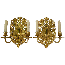 Pair of Edward F. Caldwell Old English Style Two-Light Gilt Bronze Sconces